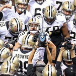Saints quarterback Drew Brees (9) huddles with teammates prior to the game against the Tampa Bay Buccaneers on Sept. 20 in New Orleans.