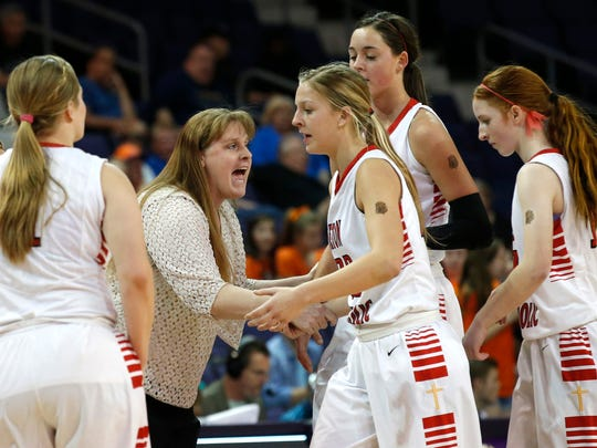 Seton head coach Karen Self  talks to her team during a timeout at the Division II girls basketball semifinals against Thunderbird at Grand Canyon University Arena in Phoenix on  February 27, 2015.