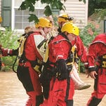 Emergency crews with the Sumner County Emergency Management Agency respond to flooding in Bethpage on Friday, July 29, 2016.