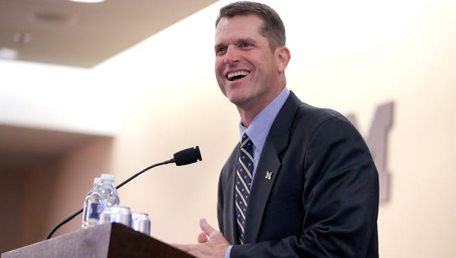 Getty Images Jim Harbaugh speaks to the media after being introduced as Michigan?s new football coach. ANN ARBOR, MI - DECEMBER 30:  Jim Harbaugh speaks as he is introduced as the new Head Coach of the University of Michigan football team at the Junge Family Champions Center on December 30, 2014 in Ann Arbor, Michigan.  (Photo by Gregory Shamus/Getty Images)