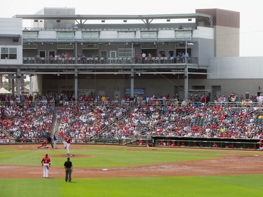The Cincinnati Reds play the Texas Rangers at the Goodyear Ballpark in March 2014.
