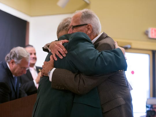 Bill Gorman, right, hugs longtime friend and acting