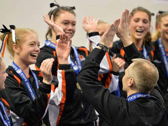 Tech head coach Joel Stark-Haws celebrates the first place win with his team at the Class 2A state high school state gymnastics team championship meet Friday, February 19 at the University of Minnesota's Sports Pavilion in Minneapolis.