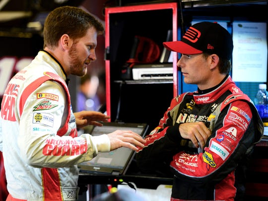 Dale Earnhardt Jr. (left) and Jeff Gordon talk in the