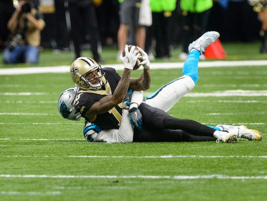 Saints wide receiver Ted Ginn Jr makes a catch as The