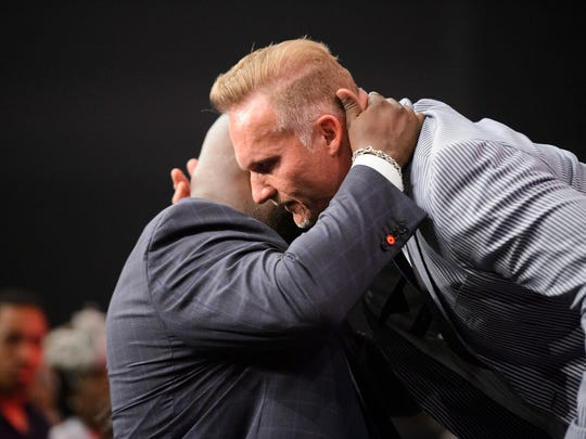 Ron Carpenter of Redemption Church hugs Pastor John Gray during the installation of pastors service at Relentless Church on Sunday, June 3, 2018.