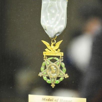 Charles Coolidge Sr. displays his Medal of Honor on