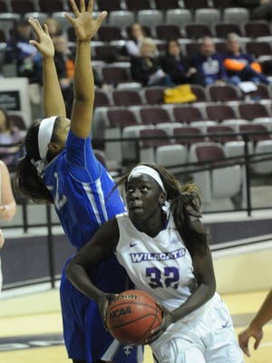ACU's Lizzy Dimba (32) drives against New Orleans' Randi Brown during the second quarter of their Southland Conference game. ACU won the game 68-55 on Tuesday, Jan. 3, 2017 at Moody Coliseum.