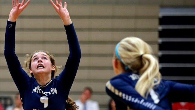 Appleton North's Maddy Ahrens sets the ball for Jenna Miller against  Neenah in a Fox Valley Association match Oct. 4 in Appleton.