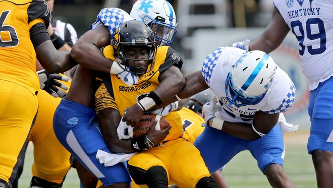 Sep 2, 2017; Hattiesburg, MS, USA; Southern Miss Golden Eagles quarterback Keon Howard (2) is tackled by Kentucky Wildcats defensive end Denzil Ware (35) and safety Darius West (25) in the second quarter at M. M. Roberts Stadium.