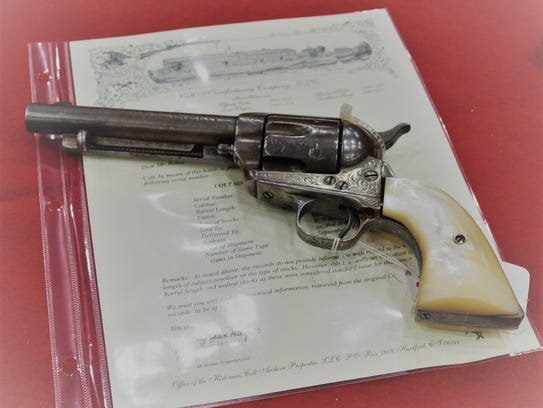 An old cowboy gun from the 1800's for sale at the All-American