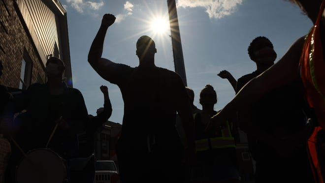 Black Lives Matter protesters march in New Jersey. A coalition of labor unions and racial and social justice organizations will stage a mass walkout from work on July 20 to protest systemic racism and police brutality. {Anne-Marie Caruso/USA TODAY Network]