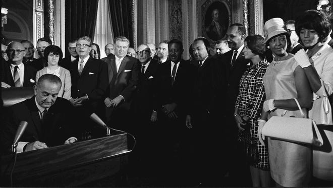 President Lyndon Johnson signing the Voting Rights Act in 1964.