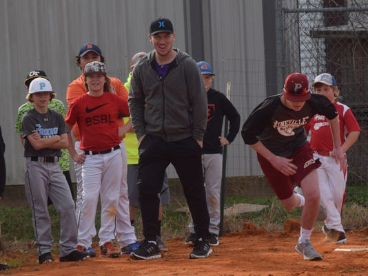 Alex Bregman (front, left), a former LSU player and an infielder for the Houston Astros, watches Pineville High School baseball player Caleb Clark run through drills in a RakeCity baseball camp held at Next Level Academy Thursday.