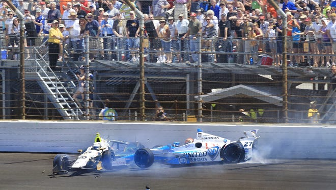 The cars of Ed Carpenter (left) and James Hinchcliffe ended up in the Turn 1 wall after tangling at Indy