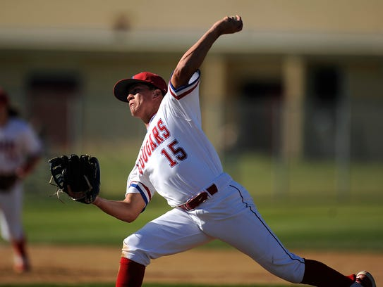 Cooper's Austin Smith (15) throws a pitch during the