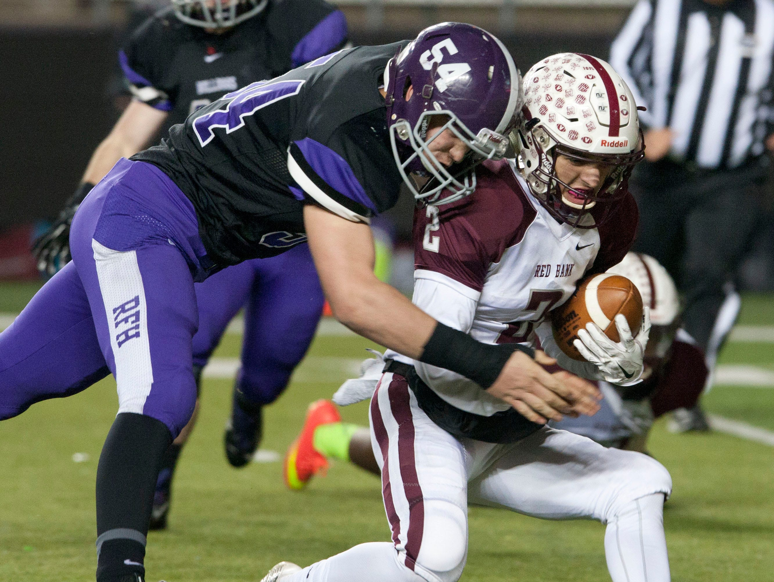 Red Bank quarterback Jack Navitsky (2) is sacked by Rumson's Chase Pfang (54) during the Central Group III championship game.