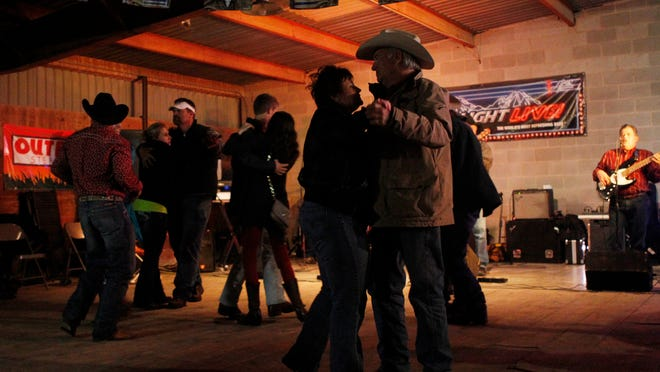 Rodeo and carnival goers make the rounds on the dance floor at the Buffalo Social Club. Because of its close proximity to the Foster Communications Coliseum, the bar sees an influx of patrons after each performance of the rodeo. (Standard-Times file photo)