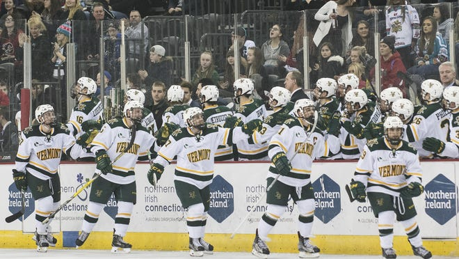 Vermont celebrates a goal during the men's hockey game between the Vermont Catamounts and the Quinnipiac Bobcats in the championship game of the Friendship Four hockey tournament in Belfast, Ireland in November.