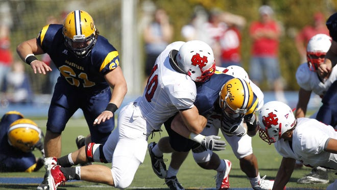 North Central College linebacker Matt Wenger, shown making a tackle, was a two-time CCIW defensive player of the year.