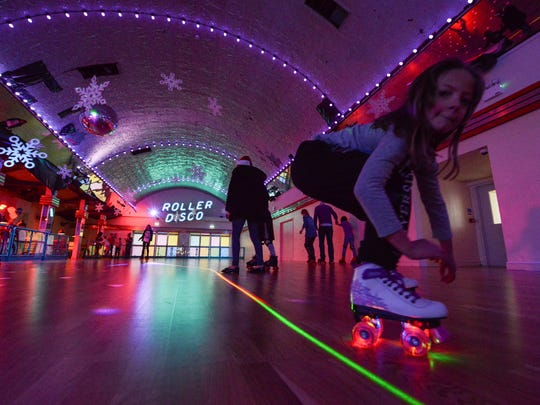 MARGATE, ENGLAND - DECEMBER 06:  Lillie Marie Byrne, 9, spins past during the festive roller skating disco at Dreamland Margate during the start of their Frosted Fairground festive season on December 6, 2015 in Margate, England. Dating from 1920, Dreamland was recently renovated and reopend earlier this year boasting the UK's oldest rollercoaster, the Grade II listed Scenic Railway.  (Photo by Chris Ratcliffe/Getty Images)
