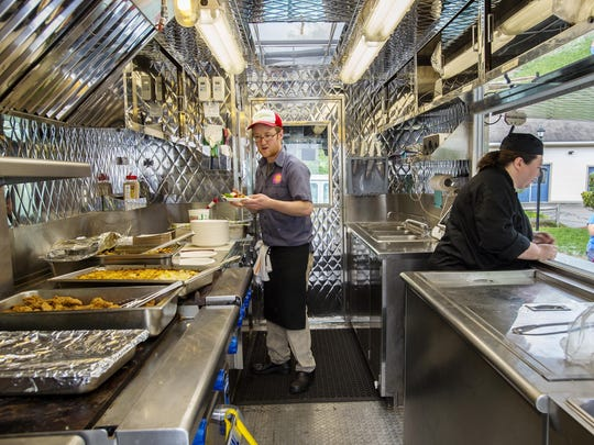 Emmet Mosely, manager of the Chittenden Emergency Food Shelf's Good Food truck, left, makes an order at the Northgate Apartments in Burlington on Wednesday, May 25, 2016.
