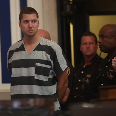 Ray Tensing, a former UC officer, enters the courtroom