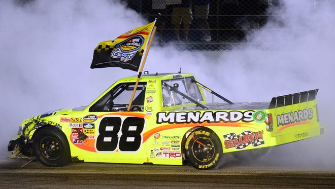 Matt Crafton does a burnout after winning the Camping World Truck Series championship after the Ford EcoBoost 200 at Homestead-Miami Speedway.