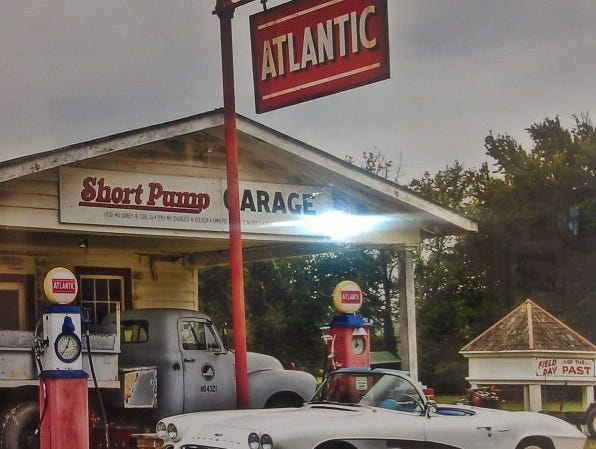 """Lucyk's 1961 Corvette stops in front of the retro """"Short Pump"""" gas station in Manakin, Va."""