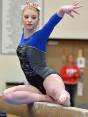 Sioux Falls O'Gorman's Lizzie Miller performs on the