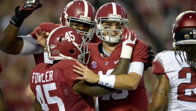 Alabama  running back Jalston Fowler celebrates with quarterback A.J. McCarron (10) after his touchdown against Arkansas.