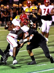 Chico Robinson (1) of Fairfield punches through the