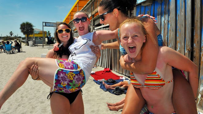 Heather Farmer, Susan Lang, Melanie Wagner and Stacey Webber, students at North Alabama, whoop it up at Cocoa Beach Pier.