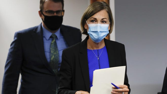 Iowa Gov. Kim Reynolds arrives to update the state's response to the coronavirus outbreak during a news conference Tuesday in Urbandale.