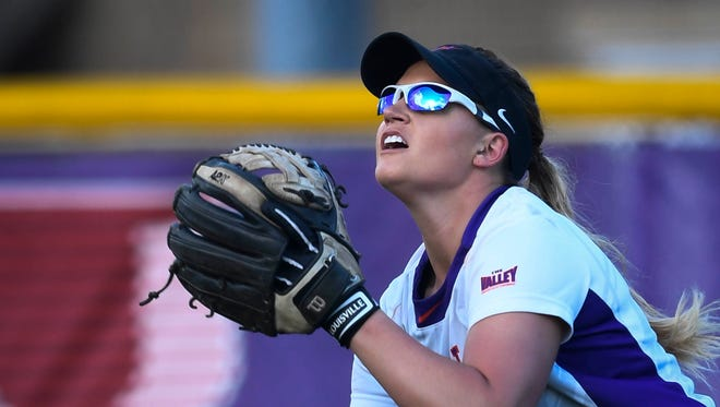 Evansville Aces' Chandra Parr chasing down a fly ball as Evansville plays Austin Peay at Cooper Stadium Wednesday. Parr hit a home run in the first game of the double header to tie the Aces' softball record, April 5, 2017.