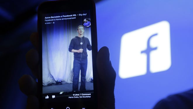 In this April 4, 2013, file photo an HTC First cell phone with the Facebook interface is seen at Facebook headquarters in Menlo Park, Calif.