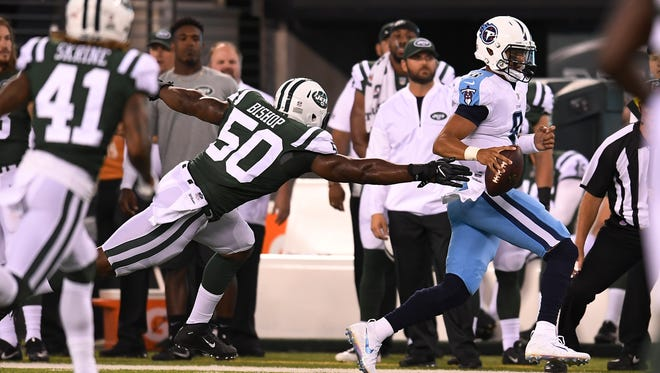 Titans quarterback Marcus Mariota (8) scrambles out of the pocket short of a first down and forcing a punt in the first quarter of a preseason game against the Jets at MetLife Stadium Saturday, Aug. 12, 2017 in East Rutherford, N.J..