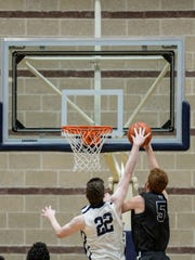 Lebanon Valley sophomore Andy Orr blocks Hood's Trevor Magnuski with 3.7 seconds left in regulation to send Wednesday's game into overtime. The Dutchmen went on to lose, 83-80.