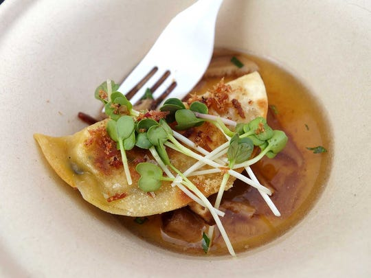 GOLD MEDAL: Roasted vegetable and chickpea gyoza with shiitake dashi, black vinegar mushrooms and house preserved beef from Clever Koi at the Devour Culinary Classic