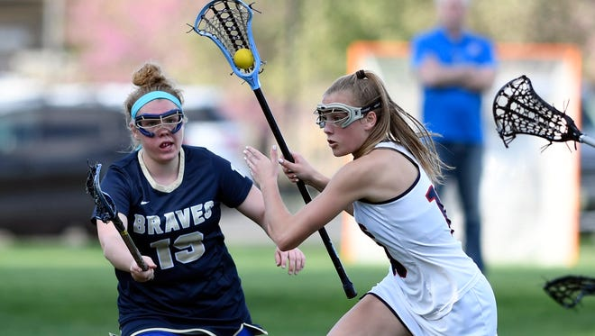 Saddle River Day's Alexa Tsahalis, right, driving to the goal. Saddle River Day and Indian Hills meet for the Bergen County girls lacrosse quarterfinal on Tuesday, May 2, 2017.
