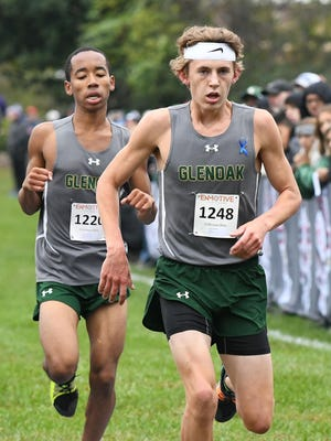 Tommy Rice finishes just ahead of GlenOak teammate Cordell Floyd for runner-up honors at last year's Federal League Cross Country Championships. Rice set a Golden Eagles record during a meet in Wooster on Saturday.