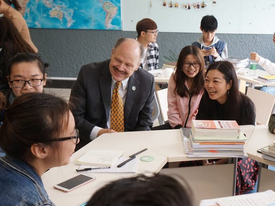 Eastern Michigan University President James Smith's April 2017 visit to China included a session at Shenyang Institute of Technology, where he observed an English class co-taught by an English native speaker in the classroom and a Chinese teacher who was in the U.S. and was teaching via online learning technology.