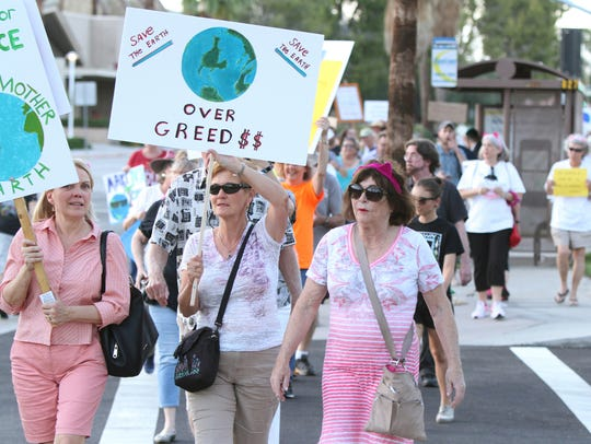 Community members participate in the March for Science
