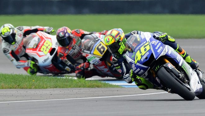 Valentino Rossi leads a group of bikes out of turn 9 during qualifying  for the MotoGP Saturday, Aug 9, 2014, at The Indianapolis Motor Speedway.