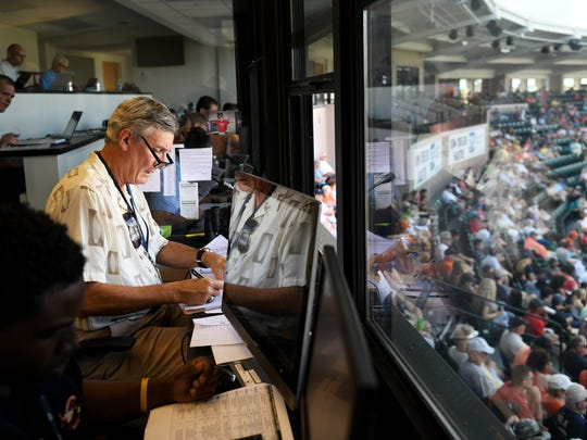 Public address announcer Bobb Vergiels makes notes on player substitutions during a Tigers-Pirates spring training game at Lakeland last week.