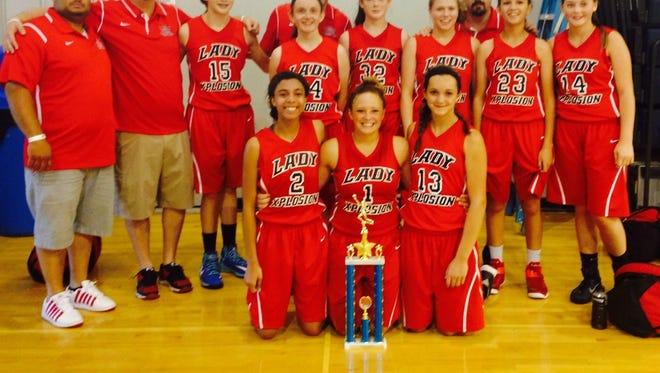 The Lady Xplosion 9th grade basketball team.