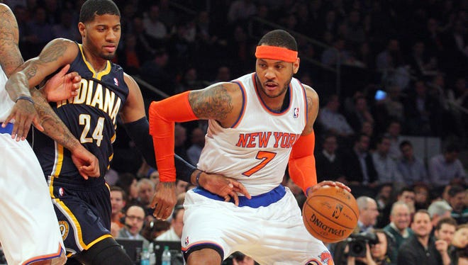 The Knicks' Carmelo Anthony, right, drives on Indiana's Paul George during the first quarter at Madison Square Garden on Wednesday night.