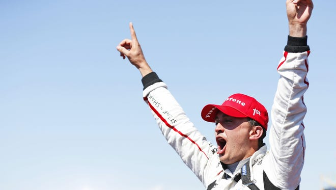Graham Rahal celebrates after winning the Honday Indy 200 at Mid-Ohio Sports Car Course on Sunday, August 2, 2015.