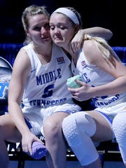 Abbey Sissom (5), left and Rebecca Reuter (24), right comfort each other before being announced at he beginning of the Old Dominion on Saturday, March 3, 2018, at MTSU.This was the last regular season home game for the seniors.