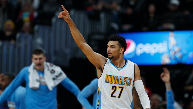 Denver Nuggets guard Jamal Murray gestures after hitting a 3-point basket against the Utah Jazz in the second half of an NBA basketball game Sunday, Nov. 20, 2016, in Denver.